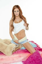Jayden Cole strips with the Puba bear watching
